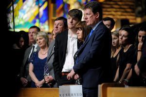 The Burke family from right, father Paul, mother Paula and brother Gavin look on during a service for Olivia Burke, 21, and Ashley Donohoe, 22, at St. Joseph Catholic Church in Cotati, Calif., on Saturday, June 20, 2015.  The two woman were among the several people killed on Tuesday when a balcony snapped off the fifth floor of a Berkeley apartment building during a birthday party. (AP Photo/Michael Short)
