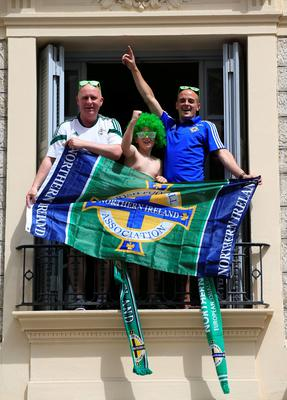 Northern Ireland fans appear on the balcony of their hotel on the seafront near Promenade des Anglais, Nice, France. PA