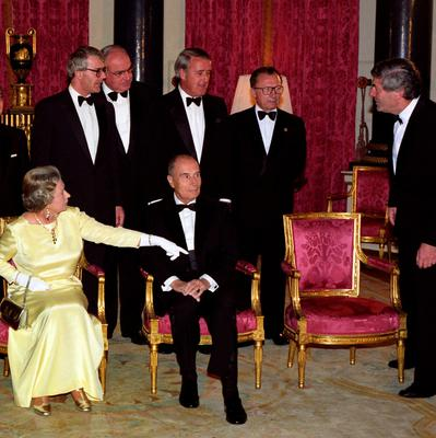 File photo dated 16/07/91 of Queen Elizabeth II gesturing to Ruud Lubbers, Prime Minister of the Netherlands and President of the EC Council of Ministers, to sit on an empty chair after the Duke of Edinburgh was absent, as the leaders of the G7 Summit countries gathered for a pre-dinner photo-call in the Music Room at Buckingham Palace, London as the Queen turns 90 on the April 21st. PRESS ASSOCIATION Photo. Issue date: Sunday April 3, 2016. See PA story ROYAL Birthday. Photo credit should read: Martin Keene/PA Wire