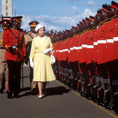 File photo dated 10/1/1983 of Queen Elizabeth II inspecting the Guard of Honour at Jomo Kenyatta International Airport as she turns 90 on the April 21st. PRESS ASSOCIATION Photo. Issue date: Sunday April 3, 2016. See PA story ROYAL Birthday. Photo credit should read: Ron Bell/PA Wire