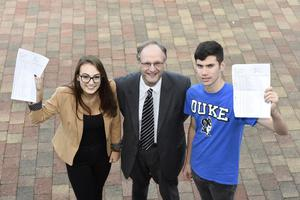 Education Minister, Peter Weir, pictured at a visit to Our Lady's and St Patrick's College with Clare Dempsey and John Toner who each received 10 A Stars in their GCSE results. Picture: Michael Cooper