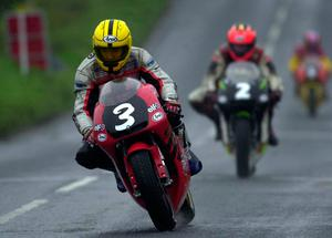 PACEMAKER, BELFAST, 29/4/2000: Joey Dunlop leads the 250cc race at the Cookstown 100. PICTURE BY STEPHEN DAVISON