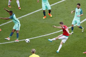 Hungary's Zoltan Gera, second from right,  scores his side's first goal during the Euro 2016 Group F soccer match between Hungary and Portugal at the Grand Stade in Decines-Charpieu, near Lyon, France, Wednesday, June 22, 2016. (AP Photo/Michael Sohn)