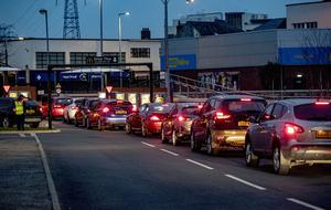 Cars queue as McDonalds Conswater in east Belfast closes at 7pm due to the COVID-19 outbreak on Monday, March 23rd 2020 (Photo by Kevin Scott for Belfast Telegraph)