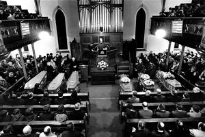 Families of murdered workmen attend an evening service in 1976 as six coffins of IRA victims are brought to church in Bessbrook the night before the funerals of those killed in the Provisional IRA's infamous sectarian Whitecross (Kingsmill) Massacre. The IRA  lined up the occupants of a workers minibus carrying 11 protestants and one catholic, before releasing the catholic man and  mowing down the 10 protestant workmen, leaving the critically injured Mr Alan Black for dead.  Alan Lewis Photopress