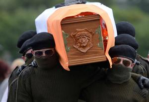 A Paramilitary  guard during  the funeral of veteran IRA volunteer Tony Catney, Which  took place at Oliver Plunkett Church in  West Belfast on wednesday  Pic Pacemaker