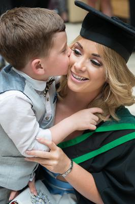 No Fee for Reproduction  Graduating from the Ulster University today with a degree in Business  is Zara Doherty from Strathfoyle who received a good luck kiss from her son Conan. Picture Martin McKeown. Inpresspics.com. 20.06.15
