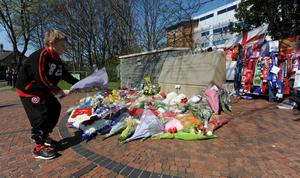 Harley Hanson (aged nine) from Sheffield places flowers ahead of the Hillsborough 25th Anniversary Memorial Service at Hillsborough, Sheffield