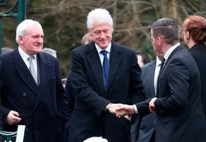 Former US President Bill Clinton (centre) and former Taoiseach Bertie Ahern (left) arriving for the funeral of Northern Ireland's former deputy first minister and ex-IRA commander Martin McGuinness, at St Columba's Church Long Tower, in Londonderry.  Niall Carson/PA Wire