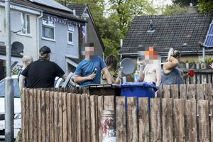 People drinking on the street close to the Westlands Road in north Belfast, during the C-19 lockdown