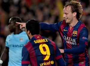 Barcelona's Croatian midfielder Ivan Rakitic (R) celebrates his goal during the UEFA Champions League round of 16 football match FC Barcelona vs Manchester City at the Camp Nou stadium in Barcelona on March 18, 2015. AFP PHOTO/ JOSEP LAGOJOSEP LAGO/AFP/Getty Images
