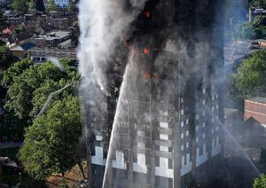 LONDON, ENGLAND - JUNE 14:  Fire fighters tackle the building after a huge fire engulfed the 24 story Grenfell Tower in Latimer Road, West London in the early hours of this morning on June 14, 2017 in London, England.  The Mayor of London, Sadiq Khan, has declared the fire a major incident as more than 200 firefighters are still tackling the blaze, while at least 30 people are receiving hospital treatment.  (Photo by Leon Neal/Getty Images)