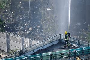 LONDON, ENGLAND - JUNE 14:  A fire fighter tackles the building after a huge fire engulfed the 24 story Grenfell Tower in Latimer Road, West London in the early hours of this morning on June 14, 2017 in London, England.  The Mayor of London, Sadiq Khan, has declared the fire a major incident as more than 200 firefighters are still tackling the blaze, while at least 30 people are receiving hospital treatment.  (Photo by Leon Neal/Getty Images)