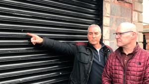 West Belfast MP Paul Maskey (right) and Sinn Fein MLA Pat Sheehan point to a mark made by a bullet during a gun attack on their constituency office earlier this month. PRESS ASSOCIATION Photo. Picture date: Friday January 11, 2019. See PA story ULSTER Attack. Photo credit should read: Rebecca Black/PA Wire