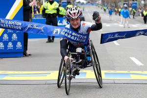 BOSTON, MA - APRIL 15:  Tatyana McFadden of the United States reacts as she crosses the finish line to win the women's wheelchair division of the 117th Boston Marathon on April 15, 2013 in Boston, Massachusetts.  (Photo by Jim Rogash/Getty Images)