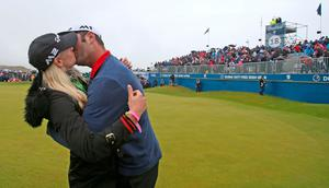 Spain's Jon Rahm celebrates winning the Dubai Duty Free Irish Open with girlfriend Kelley Cahill at Portstewart Golf Club. PRESS ASSOCIATION Photo. Picture date: Sunday July 9, 2017. See PA story GOLF Irish. Photo credit should read: Niall Carson/PA Wire. RESTRICTIONS: Editorial use only. No commercial use.