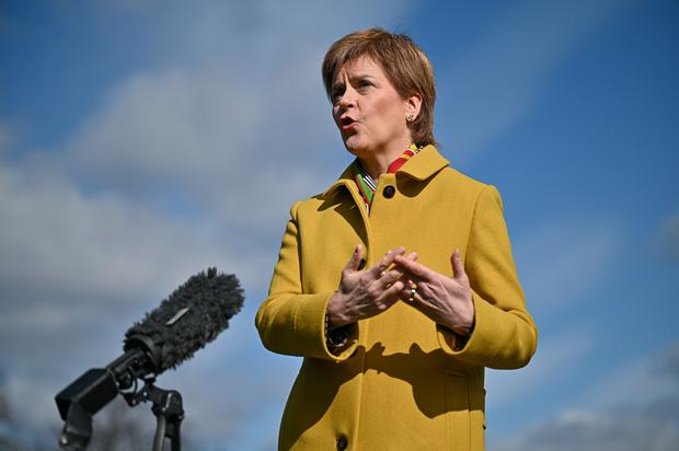 Ms Sturgeon said the move 'will eventually save families an estimated £650 a year per child' (Jeff J Mitchell/PA)