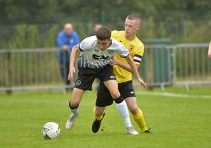 29th July 2019 Statsports Supercup NI 2019 Junior match between County Antrim and Dundalk at Broughshane. Antrims Jamie McDonnell  in action with Dundalks Scott Hearty Mandatory Credit : Stephen Hamilton/Presseye