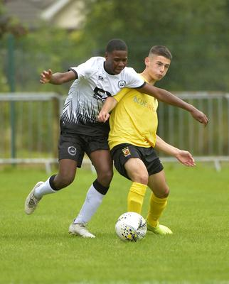 29th July 2019 Statsports Supercup NI 2019 Junior match between County Antrim and Dundalk at Broughshane. Antrims Scott Graham  in action with Dundalks Dean Peters Mandatory Credit : Stephen Hamilton/Presseye