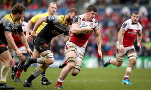Ulster's Nick Timoney breaks free to score his side's third try of the game
