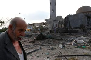 Palestinian Khaled Sharmi, 67, walks past the Al Aqsa Martyrs mosque, destroyed by an overnight Israeli strike, in Gaza City Tuesday, July 22, 2014. (AP Photo/Lefteris Pitarakis)
