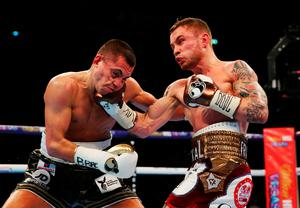Carl Frampton (R) connects with a punch on Scott Quigg during their World Super-Bantamweight title contest at Manchester Arena on February 27, 2016 in Manchester, England.  (Photo by Alex Livesey/Getty Images)