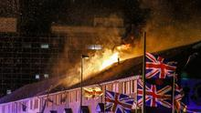 A house catches fire at the Lower Shankill bonfire as it is lit during July 12th celebrations in Belfast , 2016 ( Photo by Kevin Scott / Belfast Telegraph)