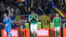 A dejected Chris Brunt after the defeat in Bucharest last night
