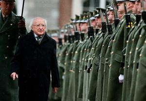 President Michael D. Higgins (second left) inspects a guard of honour during the first major event to mark the centenary of the 1916 Rising, at Dublin Castle in Ireland. PRESS ASSOCIATION Photo. Picture date: Friday January 1, 2016. Three flags which were flown on O'Connell Street during the rebellion were raised over Dublin Castle in the ceremony attended by President Michael D Higgins, Taoiseach Enda Kenny and Tanaiste Joan Burton. See PA story POLITICS Rising Ireland. Photo credit should read: Brian Lawless/PA Wire