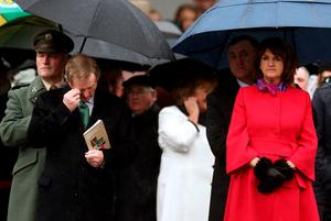 Taoiseach Enda Kenny (second left) with Tanaiste Joan Burton (right) during the first major event to mark the centenary of the 1916 Rising, at Dublin Castle in Ireland. PRESS ASSOCIATION Photo. Picture date: Friday January 1, 2016. Three flags which were flown on O'Connell Street during the rebellion were raised over Dublin Castle in the ceremony attended by President Michael D Higgins, Taoiseach Enda Kenny and Tanaiste Joan Burton. See PA story POLITICS Rising Ireland. Photo credit should read: Brian Lawless/PA Wire
