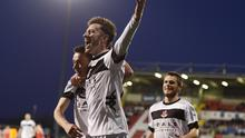 Heat of the moment: Crues skipper Paul Heatley celebrates his second strike and the clinching of the title at Solitude