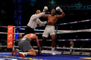 LONDON, ENGLAND - APRIL 29:  Anthony Joshua (White Shorts) puts Wladimir Klitschko (Gray Shorts) down in the 5th round during the IBF, WBA and IBO Heavyweight World Title bout at Wembley Stadium on April 29, 2017 in London, England.  (Photo by Richard Heathcote/Getty Images)