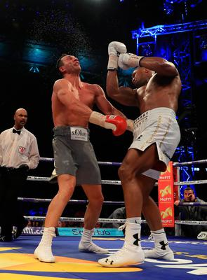 LONDON, ENGLAND - APRIL 29:  Anthony Joshua (White Shorts) and Wladimir Klitschko (Gray Shorts) in action during the IBF, WBA and IBO Heavyweight World Title bout at Wembley Stadium on April 29, 2017 in London, England.  (Photo by Richard Heathcote/Getty Images)