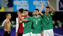 Jonny Evans (right) applauds the 600 Northern Ireland fans who returned to Windsor Park.
