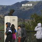 School children walk past a bust of actor James Dean during a field trip (Richard Vogel/AP)