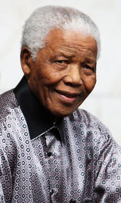 (FILE PHOTO) Former South African President Nelson Mandela Has Died Aged 95 LONDON - JUNE 26:  Nelson Mandela leaves the InterContinental Hotel after a photoshoot with celebrity photographer Terry O'Neil on June 26, 2008 in London, England. Mandela is in London in advance of the 46664 concert being held at Hyde Park on Friday the 27th June to celebrate Nelson Mandela's 90th Birthday.  (Photo by Chris Jackson/Getty Images)