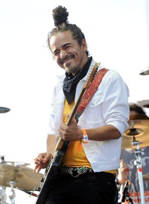 INDIO, CA - APRIL 13:  Musician Ruben Albarran of the band Cafe Tacuba performs onstage during day 2 of the 2013 Coachella Valley Music & Arts Festival at the Empire Polo Club on April 13, 2013 in Indio, California.  (Photo by Kevin Winter/Getty Images for Coachella)