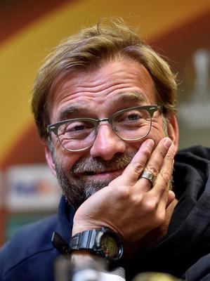 Liverpool's manager Juergen Klopp smiles during a press conference prior to the Europa League quarterfinal soccer match between Borussia Dortmund and Liverpool FC in Dortmund, Germany, Wednesday, April 6, 2016. (AP Photo/Martin Meissner)