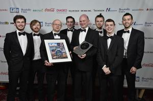 Sunday Life deputy editor Darwin Templeton presents the team from the Sunflower with the City Pub of the Year at the Pubs of Ulster Pub of the Year Awards 2015. Pic: Kelvin Boyes/Press Eye.