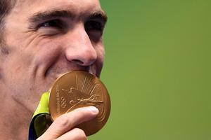 USA's Michael Phelps shows off a gold medal at the Rio Olympics in 2016