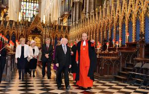The Very Reverend John Hall, Dean of Westminster Abbey, shows Irish President Michael D Higgins around Westminster Abbey in London.