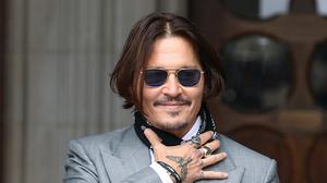 Actor Johnny Depp arrives at the High Court in London to give evidence in his libel case against the publishers of The Sun and its executive editor, Dan Wootton (Yui Mok/PA)