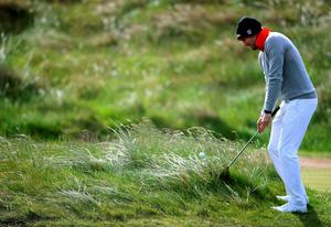 Germany's Maximillian Kiefer plays from the rough on the 1st during day two of the Dubai Duty Free Irish Open at Royal County Down Golf Club, Newcastle. PRESS ASSOCIATION Photo. Picture date: Friday May 29, 2015. See PA story GOLF Irish. Photo credit should read: Brian Lawless/PA Wire. RESTRICTIONS: Editorial use only. No commercial use. No false commercial association. No video emulation. No manipulation of images.