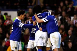 Gerard Deulofeu (obscured) of Everton celebrates with teammates after scoring the opening past goalkeeper Asmir Begovic of Stoke during the Barclays Premier league match between Everton and Stoke City at Goodison Park on November 30, 2013 in Liverpool, England.  (Photo by Clive Brunskill/Getty Images)