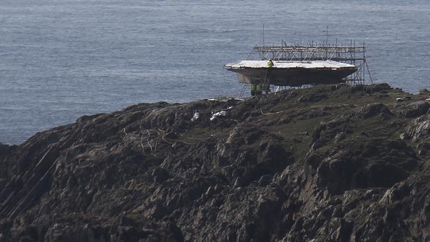 Construction on the millennium falcon which is perched on rocks on the rugged landscape at Ireland's most northerly point - Malin Head. Picture James Whorriskey.