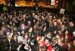 LONDON, ENGLAND - JANUARY 11:  Members of the public gather outside the Ritzy Cinema in Brixton to pay tribute to David Bowie on January 11, 2016 in London, England. British music and fashion icon David Bowie died earlier today at the age of 69 after a battle with cancer. (Photo by John Phillips/Getty Images)