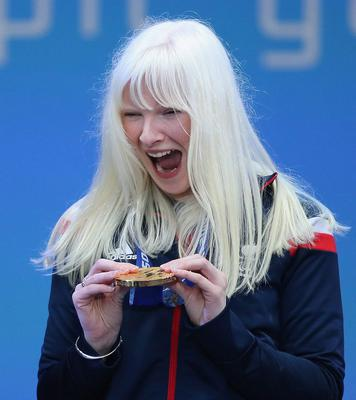 Golden girl: an ecstatic Kelly Gallagher celebrated being awarded her prize at the Winter Paralympic Games in Sochi in 2014