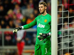 MUNICH, GERMANY - APRIL 09:  David de Gea of Manchester reacts during the UEFA Champions League quarter-final second leg match between FC Bayern Muenchen and Manchester United at Allianz Arena on April 9, 2014 in Munich, Germany.  (Photo by Lennart Preiss/Bongarts/Getty Images)