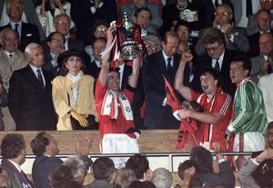 File photo dated 17/05/1990 of Manchester United captain Bryan Robson holds up the FA Cup after the presentation by the Duke of Kent following United's 1-0 victory over Crystal Palace in the FA Cup replay at Wembley. PRESS ASSOCITAION Photo. Issue date: Wednesday May 8, 2013. Sir Alex Ferguson will retire at the end of this season, Manchester United have announced. See PA Story SOCCER Man Utd. Photo credit should read: PA Wire.