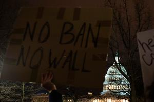 Demonstrators protest against US President Donald Trump and his administration's ban of travelers from 7 countries by Executive Order, during a rally outside the US Supreme Court in Washington, DC, on January 30, 2017. Trump's executive order suspended the arrival of all refugees for at least 120 days, Syrian refugees indefinitely -- and bars citizens from Iran, Iraq, Libya, Somalia, Sudan, Syria and Yemen for 90 days.  Protests are taking place at airports across the country in opposition to the ban. / AFP PHOTO / ZACH GIBSONZACH GIBSON/AFP/Getty Images
